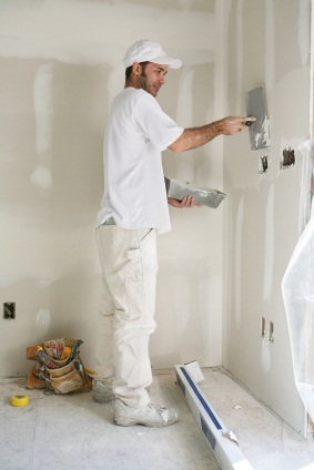 Drywall repair being performed by an experienced J. Mota Services drywall technician.